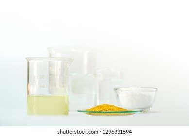 Cosmetic chemicals ingredient on white laboratory table. Polyaluminium Chloride, Carnauba wax flakes sp-200, Nickle chloride liquid, Microcrystalline wax, alcohol