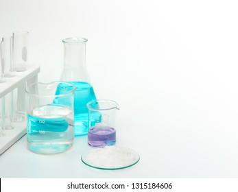Cosmetic chemicals ingredient on white laboratory table. Potassium Chloride, Potassium Permanganate Liquid, Nickle Chloride, Alcohol