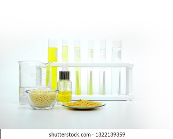 Cosmetic chemicals ingredient on white laboratory table. Carnauba Wax Flakes SP-200, Candelilla Wax SP-75, Nickle chloride liquid, alcohol