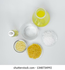 Cosmetic chemicals ingredient on white laboratory table. Carnauba Wax Flakes SP-200, Candelilla Wax SP-75, Microcrystalline wax, Nickle chloride liquid, alcohol