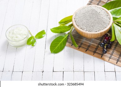 cosmetic clay in bamboo bowl and face cream