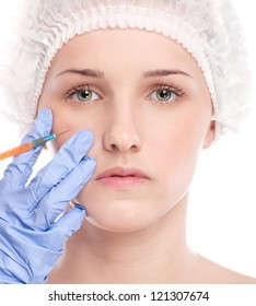 Cosmetic collagen injection in the female face. Cheek zone. Isolated on white