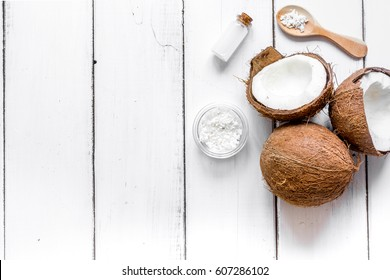 cosmetic concept with fresh coconuts on white table background top view
