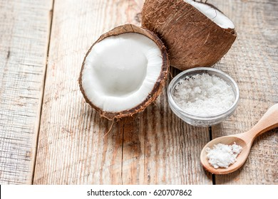 cosmetic concept with fresh coconuts on old wooden table background