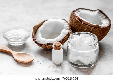 cosmetic concept with fresh coconuts on white table background