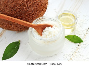 Cosmetic container of dried coconut shavings, coconut, coconut oil. Home natural skincare spa treatment.