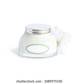 cosmetic cream in a glass jar on white background with white flower in the background