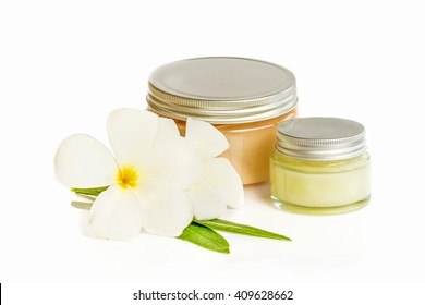 cosmetic cream isolated on white with frangipani flower