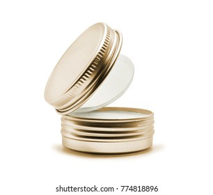 Cosmetic cream in a metal jar isolated on white background