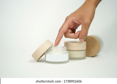 Cosmetic cream and woman's hand a mockup product with white background