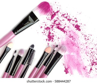 Cosmetic crushed make up powder with brush isolated on white