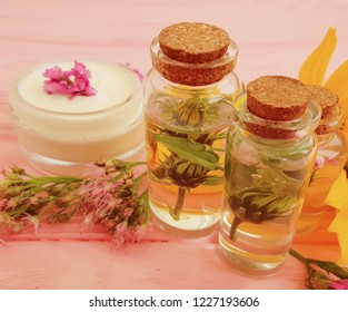 cosmetic essence, flowers on wooden background