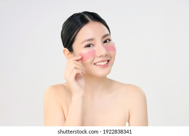 Cosmetic Eye Mask. Close Up Beauty Face Asian Woman With Fresh Clean Skin Using Eye Pad. Eye Care Treatment. Isolated on white. Beauty And Skin Care Concept.