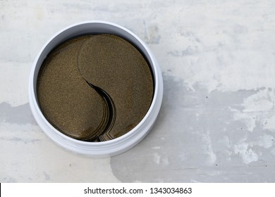 cosmetic eye patches in white box on ceramic  background
