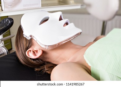Cosmetic face mask. the girl is wearing a mask. Promotional Products. health and beauty of the face. LED Facial Mask, Beauty Photon Therapy