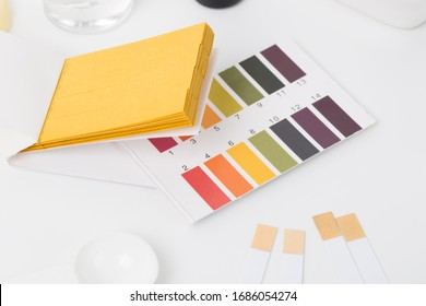 Cosmetic ingredients safety testing tools, pH value, water powder value, moisture degree, pH test paper, dropper, chemical solvent, and rubber gloves in white background