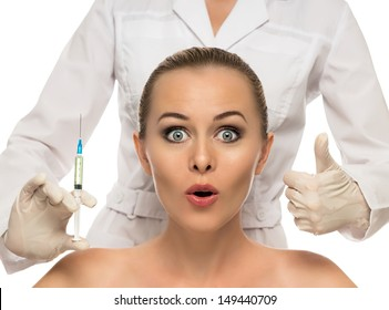 Cosmetic injection to the pretty Beautiful woman face and beautician hands with syringe. Doctor woman giving botox injections. Isolated on the white background.