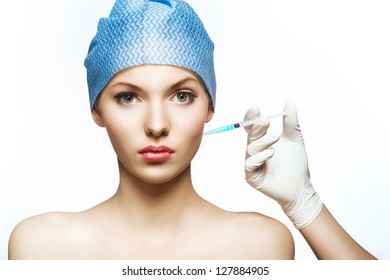 Cosmetic injection to the pretty female face.
