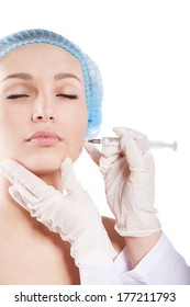 Cosmetic injection to the pretty woman face isolated over white