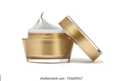 cosmetic jar and cream on white background
