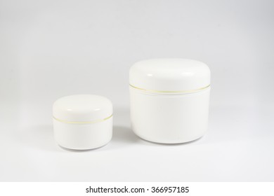 Cosmetic jars on white background.