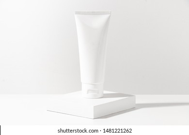 cosmetic lotion cream mockup bottle pakage with white wood plate, beauty spa treatment and medical skin care concept