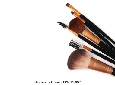 Cosmetic makeup brush set, makeup applicator pile isolated on white background, top view