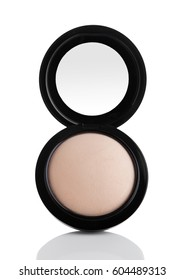 Cosmetic Makeup Powder in Black Round Plastic Case with Mirror on White Background with reflection