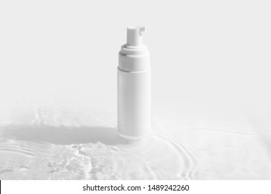cosmetic mockup white fresh spray cream bottle packaging with beauty spa treatment concept on water wave clear