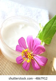 cosmetic moisturizing cream with flower