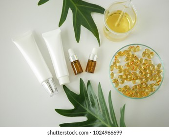 Cosmetic package containers . natural organic beauty product concept mock up with green leaves,herbal . Blank bottle for label skincare. isolated white background.top view.