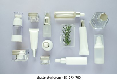 cosmetic packaging set on purple background. group of skincare cream serum oil . facial beauty cosmetic spa product. natural cosmetology concept skin treatment with green leaf and laboratory science.