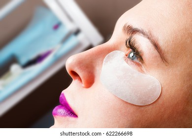 cosmetic patch on the face of the girl in the beauty salon