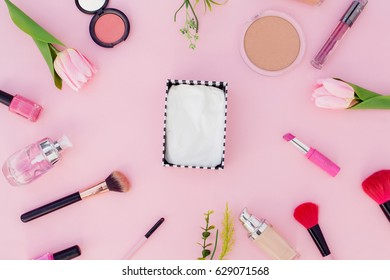 cosmetic pink background with flowers,Top view.Flat lay