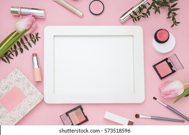 Cosmetic pink frame with flowers. Top view. Flat Lay