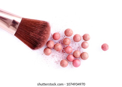 Cosmetic powder balls and makeup brush, isolated on white background. Shallow depth of focus