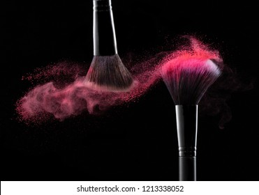Cosmetic powder burst with two brushes