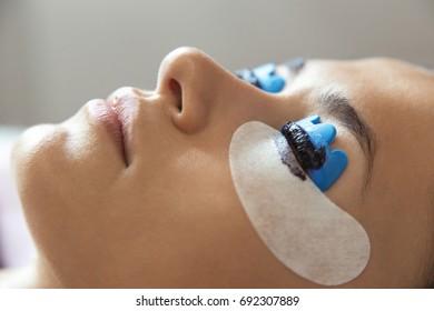 Cosmetic procedure for staining eyelashes. Extension, perm, lamination of eyelashes. Eyelash care