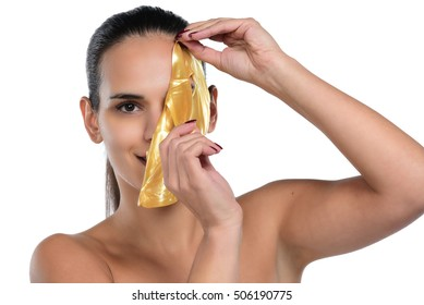Cosmetic procedure, the woman's face with gold mask  on white background