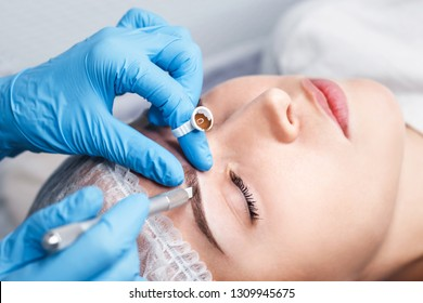 Cosmetic procedures for the treatment of eyebrows. Microblading in the beauty salon. Professional cosmetology. Processing eyebrow manipula.