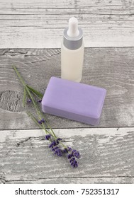 Cosmetic products and lavender on weathered wood