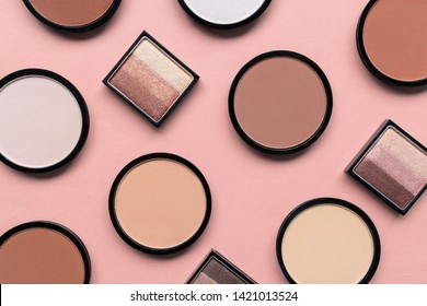 Cosmetic products for make-up on a pastel beige background. Eyeshadow and blush for different skin colors concept. Trendy beauty pattern coral color. Colorful texture. Living. Trending shades.