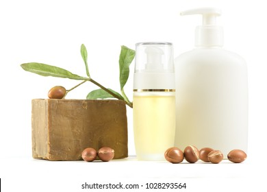 Cosmetic products and soap with argan fruits for skin care and hair on a white background. Space for labels and graphics