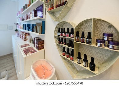Cosmetic section with nail polish, facial cream, conditioners, shampoo and hair treatment in store