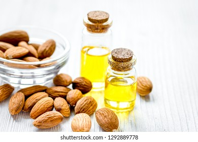 cosmetic set with almond oil on wooden table background