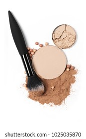 Cosmetic set of compact and loose face powder, bronzed pearls and makeup brush isolated on white background. Top view point, flat lay.