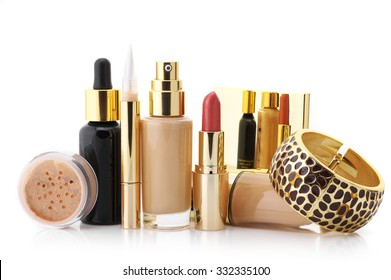 Cosmetic set: liquid foundation, concealer, mineral powder, lipstick, face serum and bracelet isolated on white background.