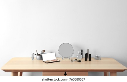 Cosmetic set with mirror on dressing table