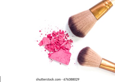 Cosmetic set with powder, cheek and eye shadow brush a white background.