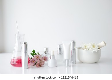 cosmetic skincare beauty product .natural organic flower oil ingredient in the laboratory. packaging spa concept.